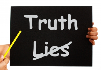 Pointing Truth On Blackboard Stock Photo